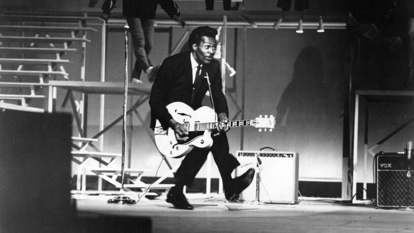 """Chuck Berry performs his """"duck walk"""" at a performance in Santa Monica in 1964. (Michael Ochs Archives / Getty Images)"""