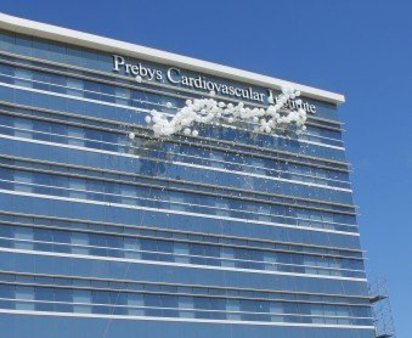 Scripps unveils the sign for the Prebys Cardiovascular Institute with a dramatic balloon explosion. Conrad Prebys donated $45 million toward the project, the largest gift in Scripps Health history.