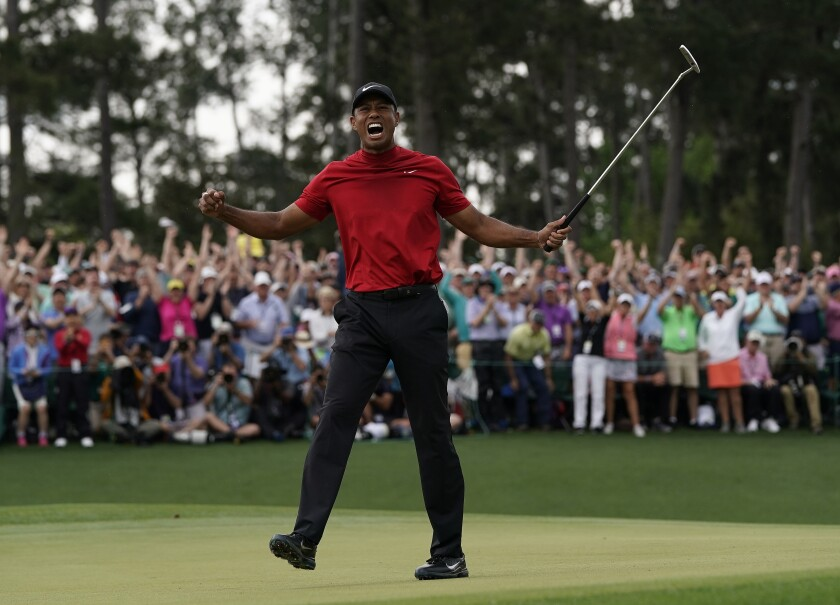 Tiger Woods of the United States celebrates after winning the Masters at Augusta National Golf Club on Sunday in Augusta, Ga.
