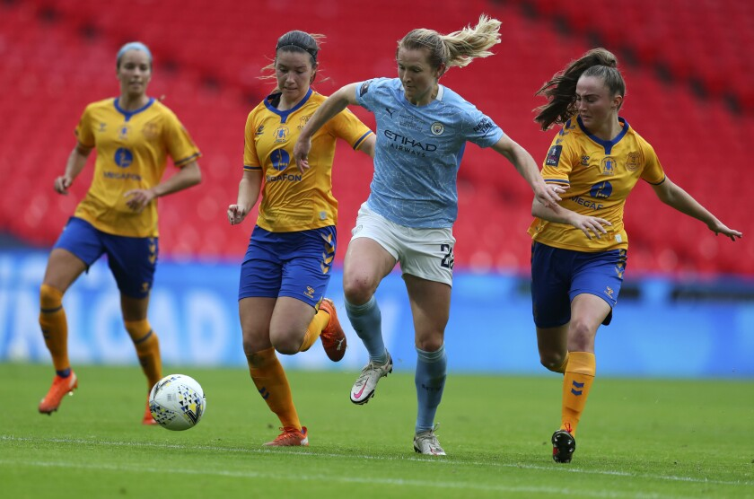 Manchester City's Sam Mewis controls the ball ahead of Everton players during the Women's FA Cup final on Nov. 1.