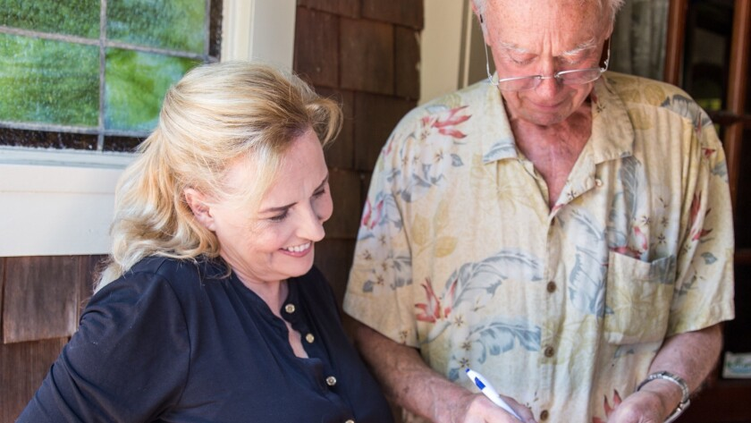 Allison Mathews gets a signature from Laguna Beach resident John Cloak to support her candidacy for the City Council.