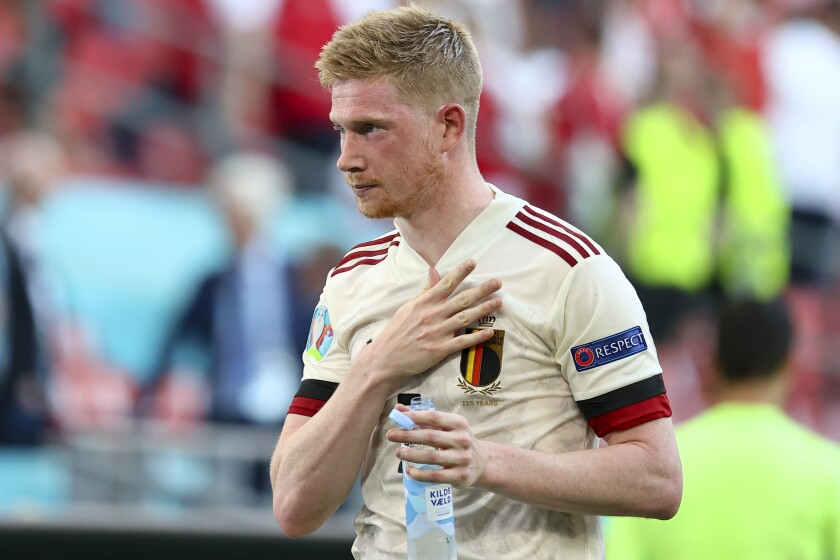 Belgium's Kevin De Bruyne celebrates his side's 2-1 win after the Euro 2020 soccer championship group B match between Denmark and Belgium, at the Parken stadium in Copenhagen, Thursday, June 17, 2021. (Wolfgang Rattay, Pool via AP)