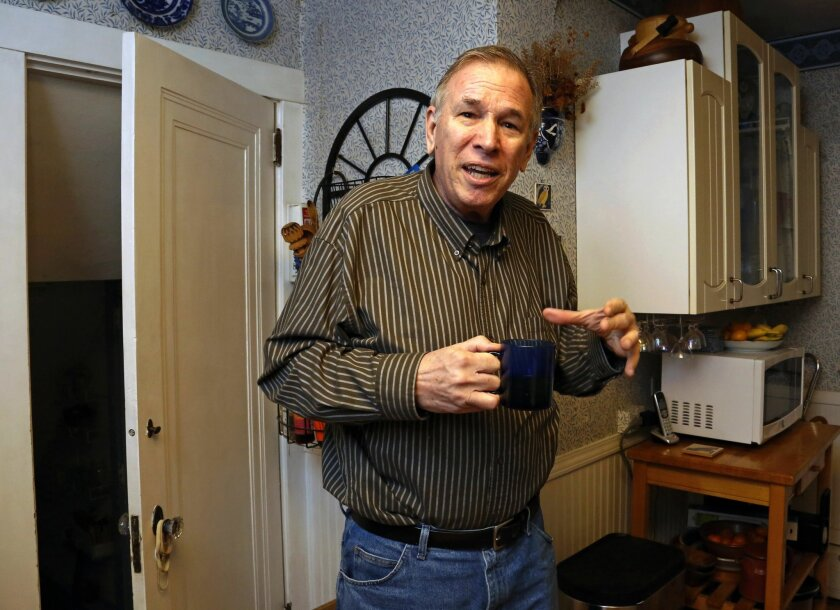 """Dave Bostick has a cup of tea in the kitchen of his home in Pittsburgh, Tuesday, Feb. 16, 2016. Bostick, 71, a retired vocational rehab counselor, said his low mood and energy level improved """"a little bit"""" during a testosterone treatment study but suddenly worsened afterward. He said he has resumed"""