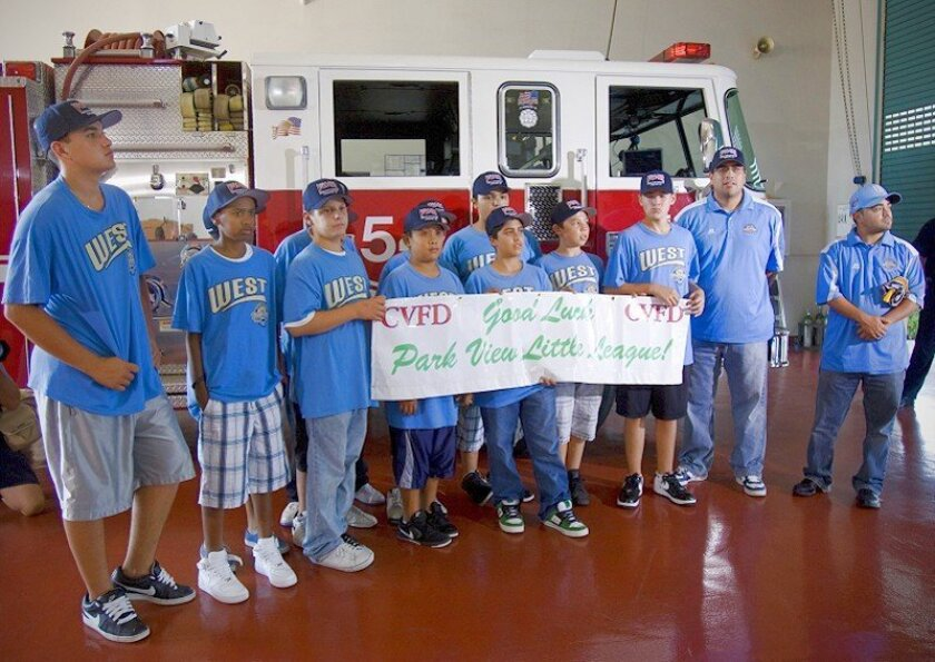 Members of the Park View Little League World Series champions were presented with the banner that was attached to Engine 59 by firefighters at Fire Station 4 in Rancho Del Rey during the team's title run.