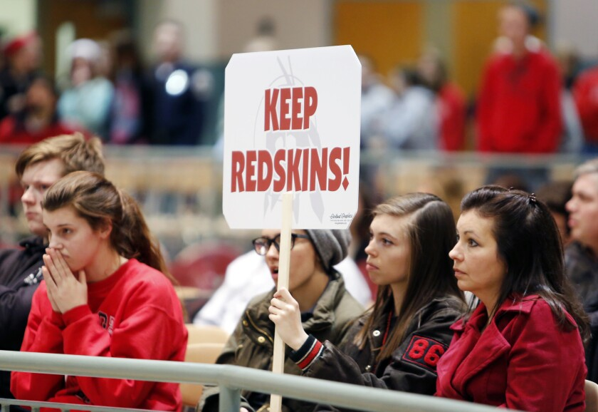 Students listen as the Lancaster New York School Board voted to retire the Redskins team mascot and nickname in that town last year. A similar effort is underway in California.
