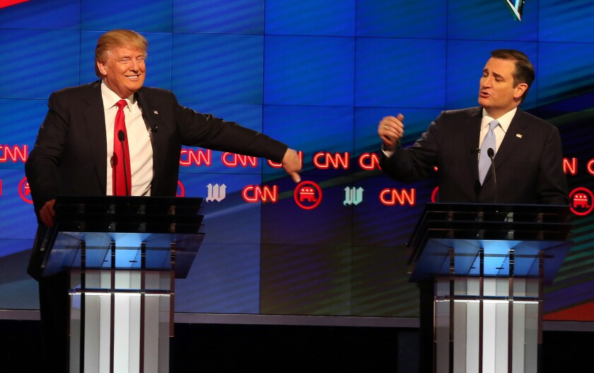 Donald Trump and Ted Cruz face off during the Republican presidential debate in Miami on Thursday.