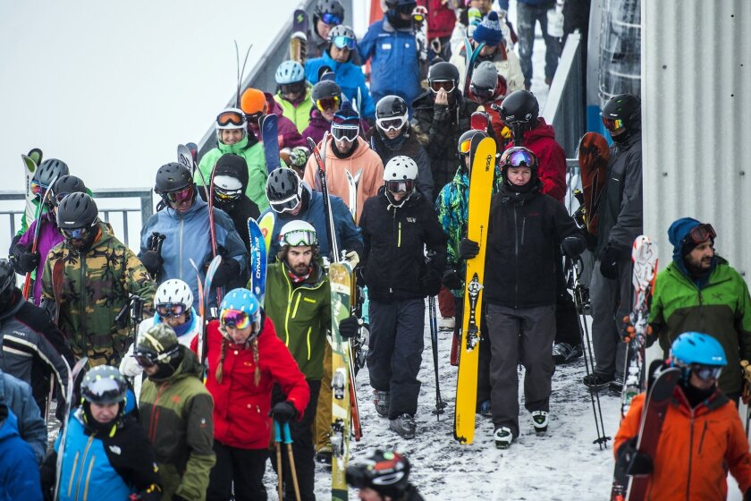 This photo taken Dec. 30, 2016, shows skiers and snowboarders offloading at the tram at Hidden Peak at Snowbird Ski and Summer Resort in Snowbird, Utah. Utah ski resorts recorded a 10-year high for visitors this past season, likely fueled by good early-winter snow and buzz created by Vail Resort's