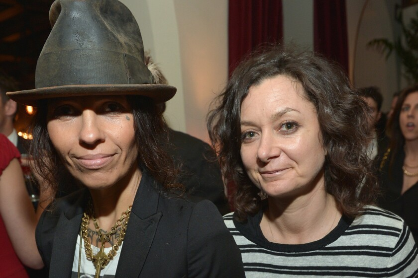 """Musician Linda Perry, left, and """"The Talk"""" panelist Sara Gilbert, shown at an event in Hollywood in February, got married on Sunday."""