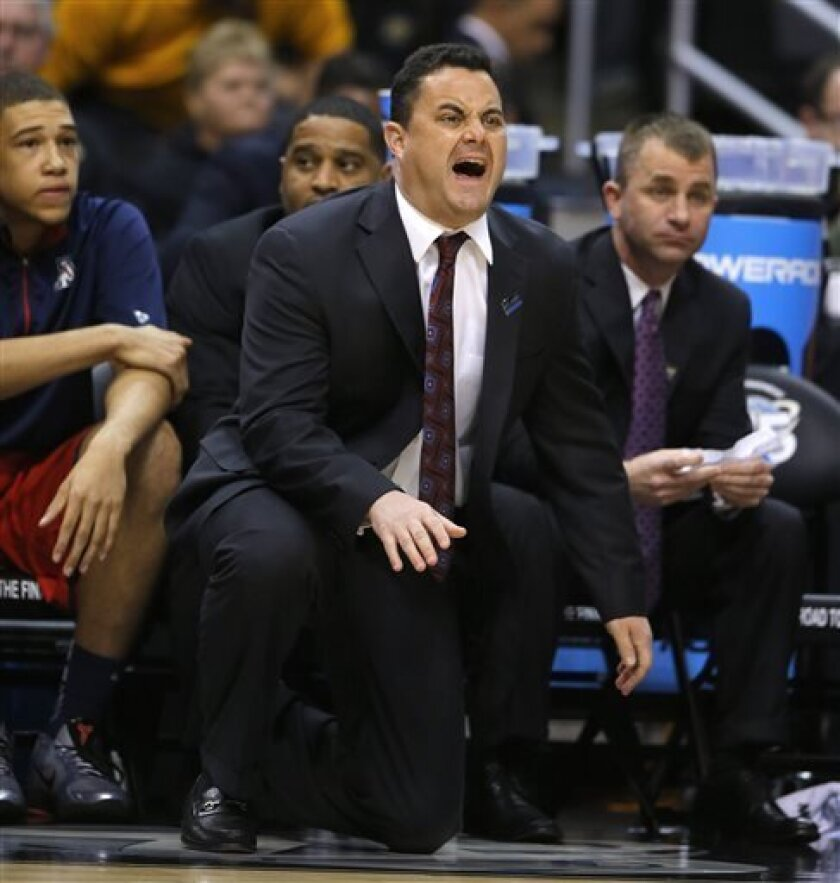 Arizona coach Sean Miller calls to his players during the first half of a West Regional semifinal against Ohio State in the NCAA men's college basketball tournament, Thursday, March 28, 2013, in Los Angeles. (AP Photo/Jae C. Hong)