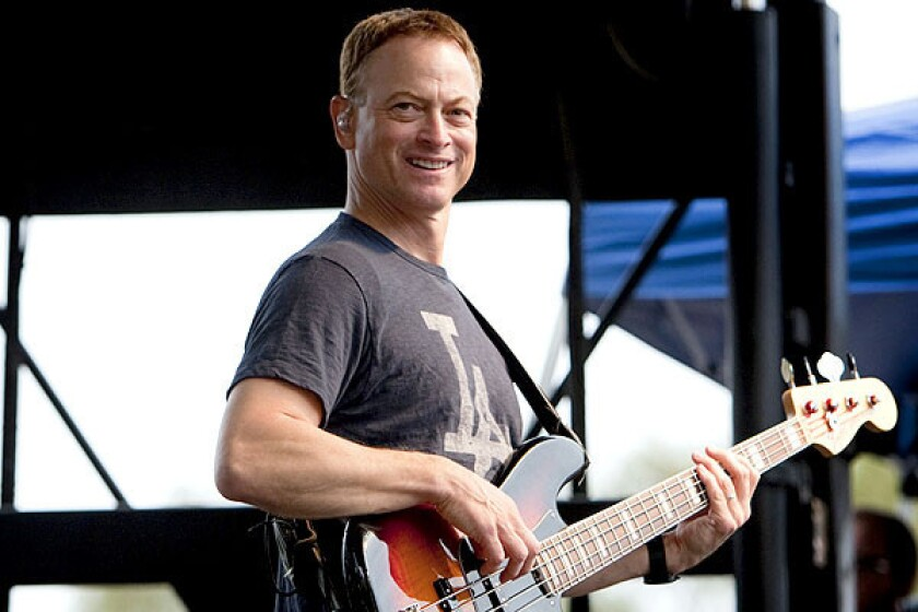 Actor Gary Sinise's half-acre estate holds a two-story farmhouse, a charming guest suite and a backyard with a pool, spa and koi pond.