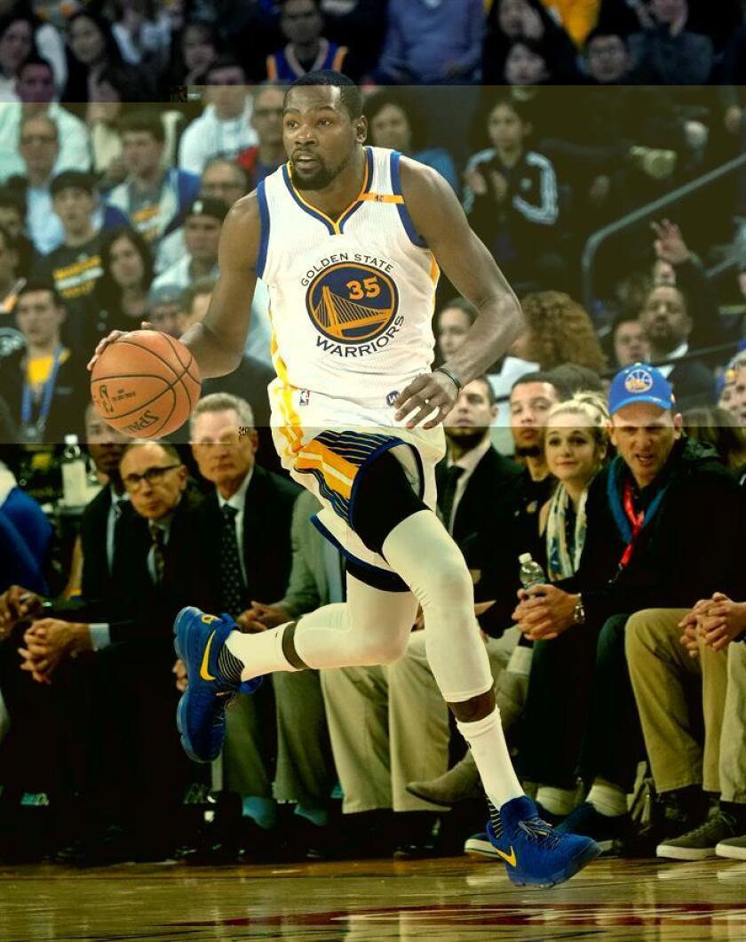 El jugador de los Warriors Kevin Durant en acción durante un partido de la NBA. EFE/Archivo