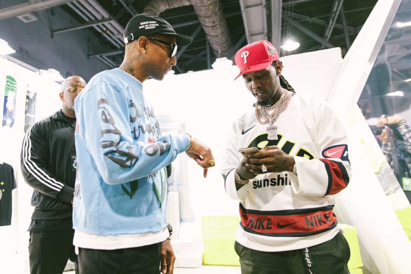 Singer Pharrell Williams and rapper Offset at ComplexCon in Long Beach.