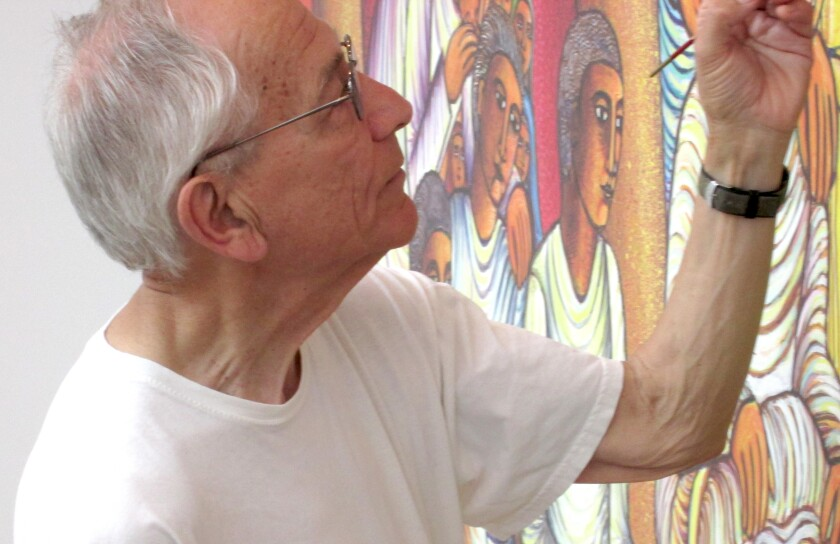 John Swanson at work on one of his art pieces.