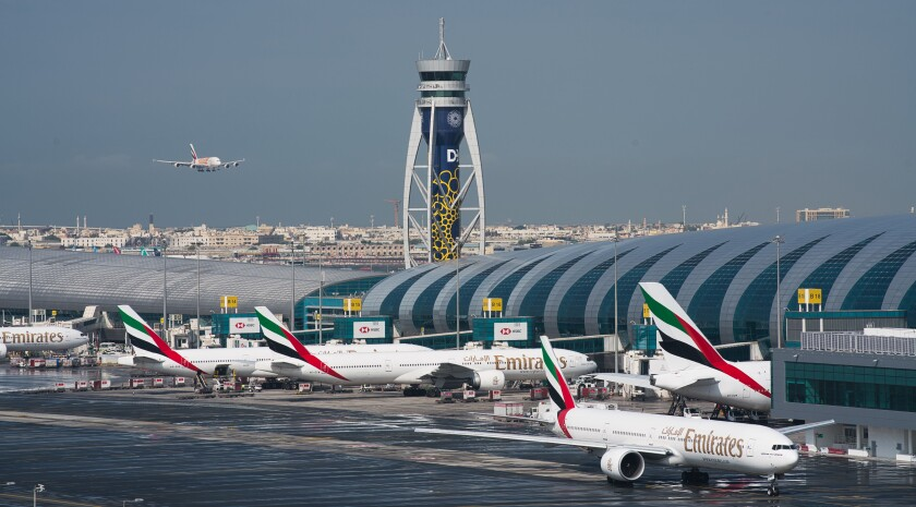 FILE - In this Dec. 11, 2019, file photo, an Emirates jetliner comes in for landing at the Dubai International Airport in Dubai, United Arab Emirates. Two passenger jets from low-cost carrier FlyDubai and Bahrain-based Gulf Air collided with each other on the taxiway at Dubai International Airport early Thursday, July 22, 2021, though authorities reported no injuries in the incident. (AP Photo/Jon Gambrell, File)