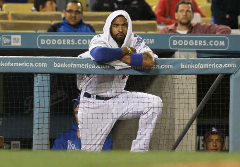 Matt Kemp wears a towel on his head while it rains during the Dodgers' April 25 game against the Atlanta Braves.