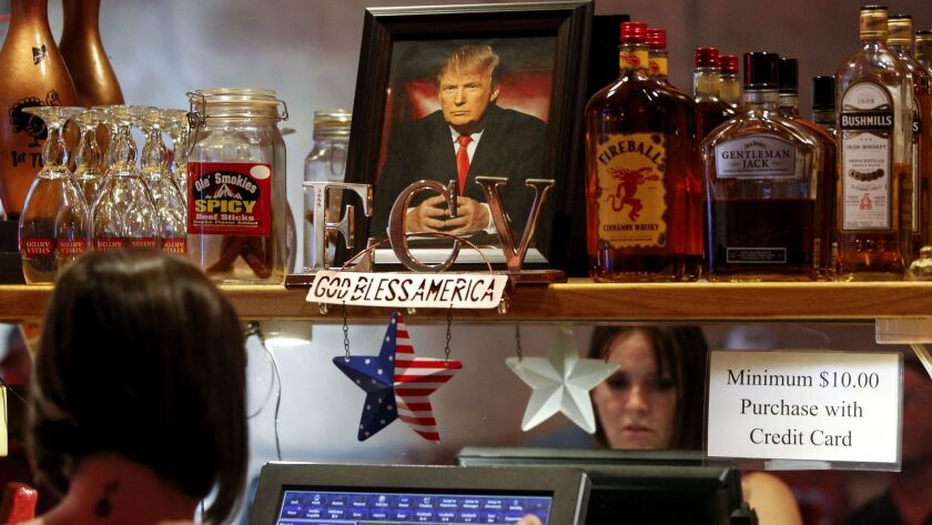 RAMONA, October 4, 2018 | A picture of President Donald Trump sits on a shelf above a cash register