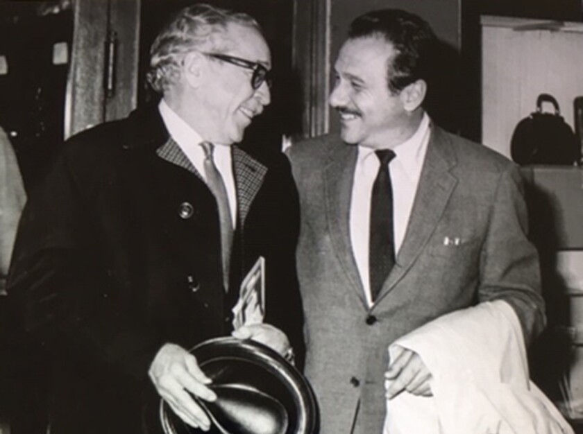 Edward Lewis, right, with screenwriter Dalton Trumbo in 1967.