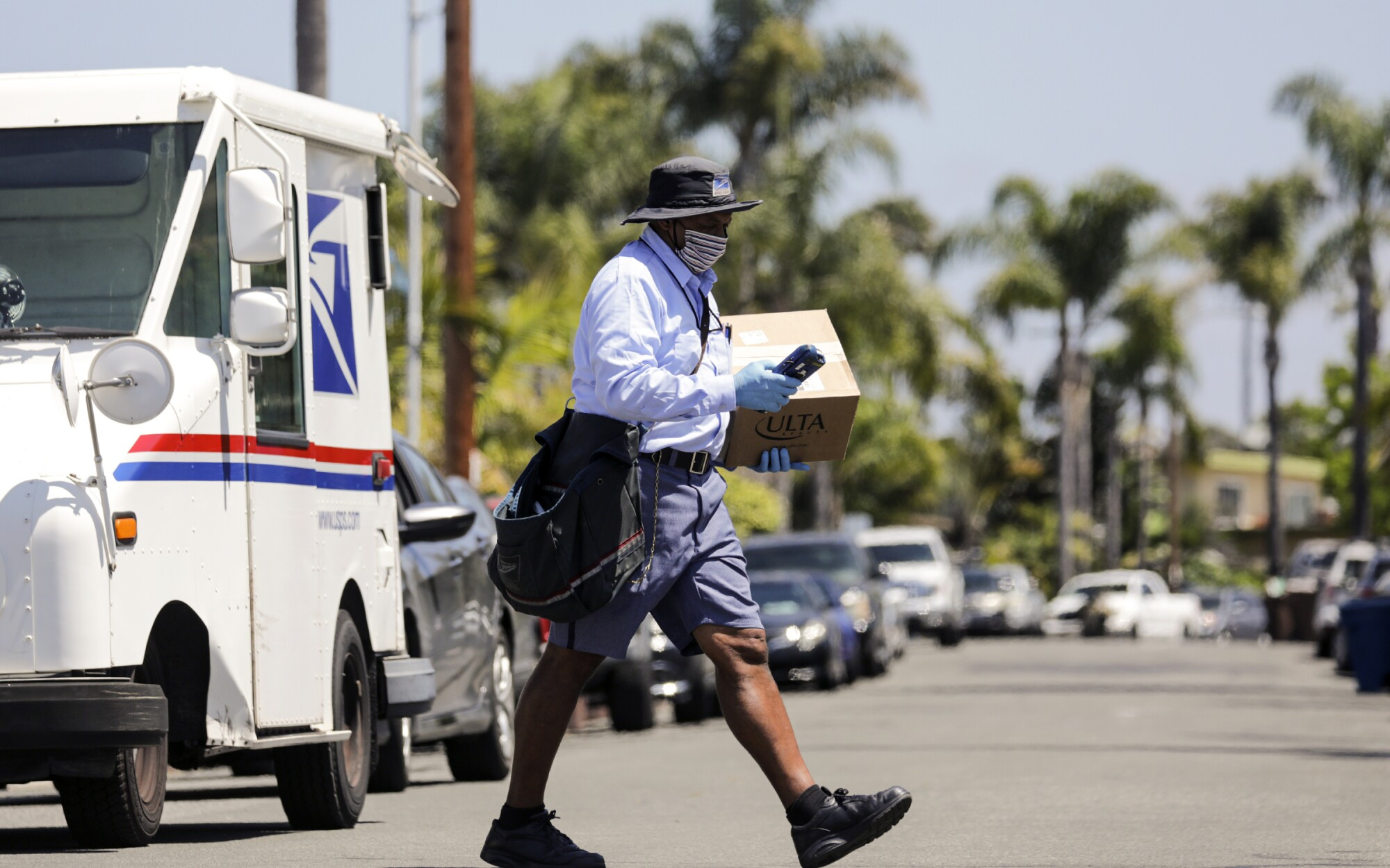 James Daniels, 59, on his mail delivery route on May 15 in San Clemente.