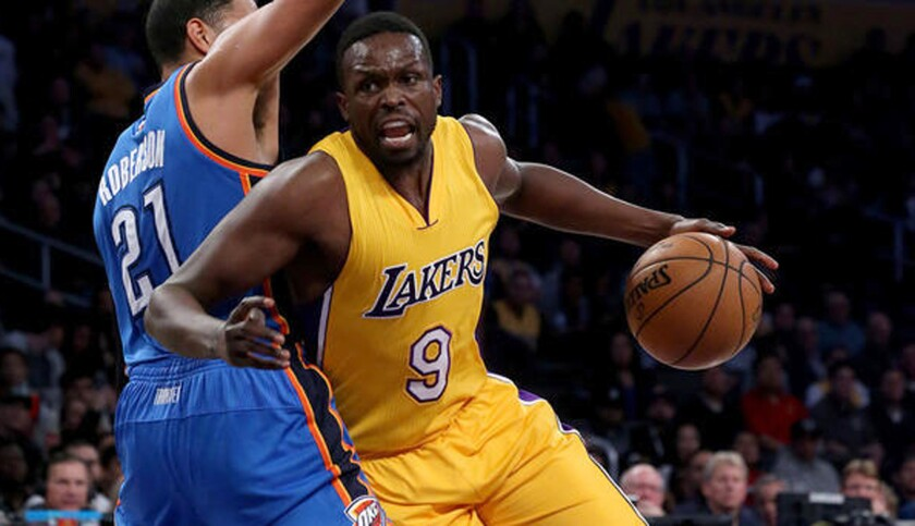 Luol Deng drives against Oklahoma City's Andre Roberson during a Lakers game in November of 2016.