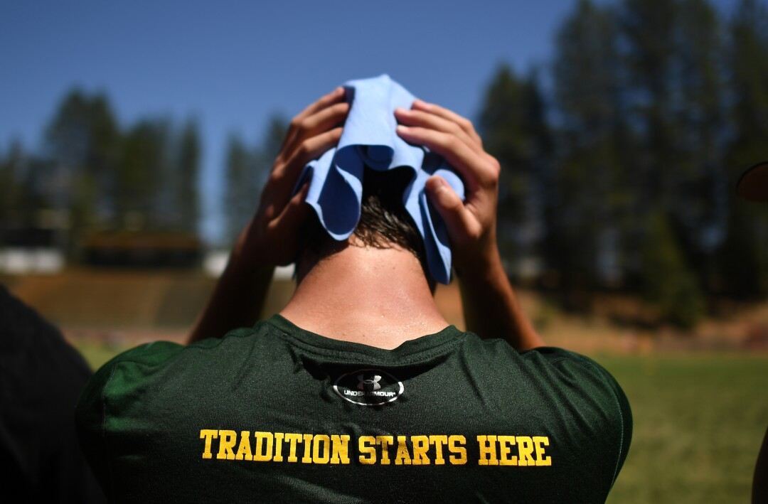 A Paradise football player cools down during a training camp practice session.
