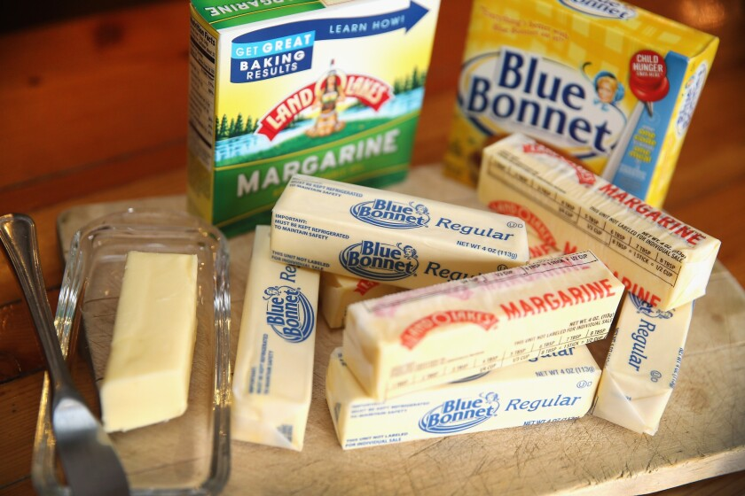 Stick margarine and other food items which contain trans fat are shown in Chicago, Illinois. The FDA announced it has banned partially hydrogenated oils from the U.S. food supply.