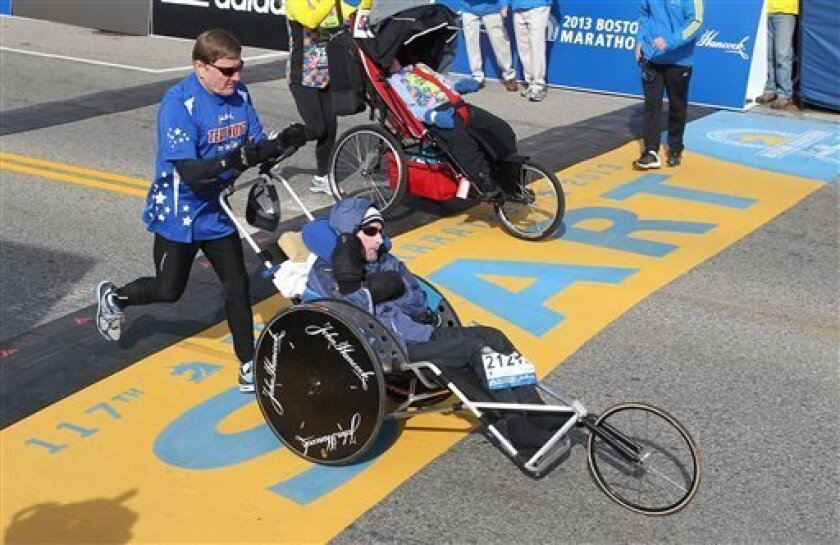Dick Hoyt, left, and his son, Rick, start of the 117th running of the Boston Marathon, in Hopkinton, Mass., Monday, April 15, 2013. (AP Photo/Stew Milne)