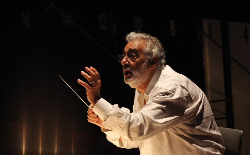 """Placido Domingo conducting during a dress rehearsal for Los Angeles Opera's 2013 production of """"Carmen"""" at the Dorothy Chandler Pavilion."""