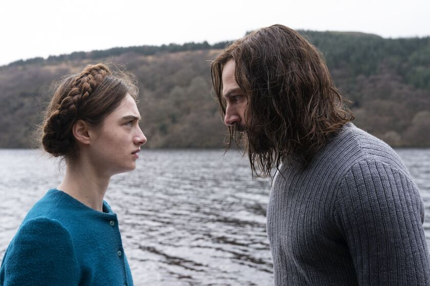 Raffey Cassidy and Michiel Huisman in the movie 'The Other Lamb'