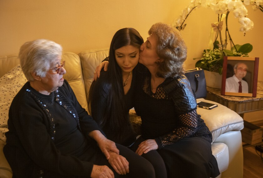 Oganes' mother, Sousanna Papazyan, and sister, Gayane Telalyan, console Julianna at the family home in Burbank.