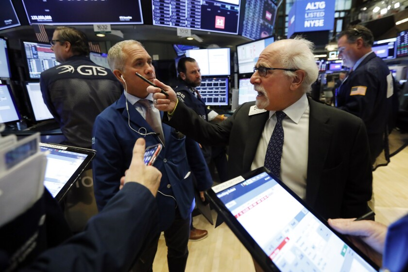 Traders Timothy Nick, left, and Peter Tuchman at the New York Stock Exchange.