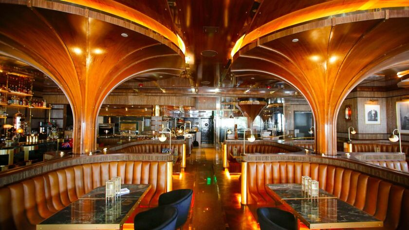 More than a year after its scheduled opening, Born & Raised, a glamorous, wood- and marble-embellished steakhouse in the heart of Little Italy, formally opens Wednesday.
