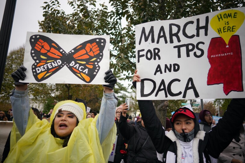 Immigration rights activists with signs took part in a rally.