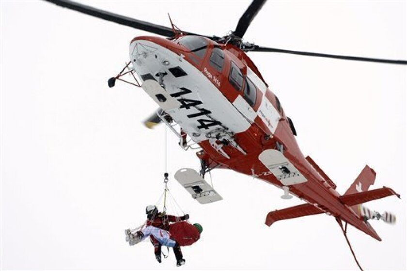 Klaus Kroell, of Austria is airlifted after crashing into the safety net, during the men's World Cup Super G of the Alpine Ski World Cup finals, in Parpan - Lenzerheide, Switzerland, Thursday, March 14, 2013. (AP Photo/Keystone, Peter Schneider)