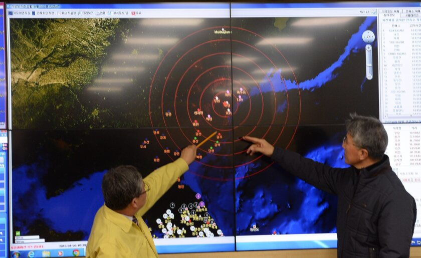 Ko Yun-hwa, left, of South Korea's Meteorological Administration, and Yun Won-Tae of the Korea Meteorological Administration look at a screen showing seismic waves from North Korea.