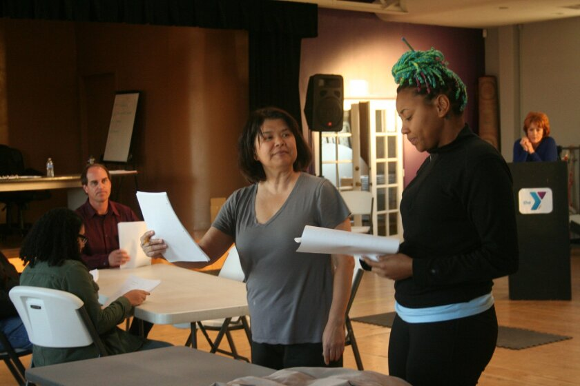 Actors Savvy Scopelleti and Whitney Brianna Thomas (foreground, left to right) work on a scene from a Plays by Young Writers festival piece.
