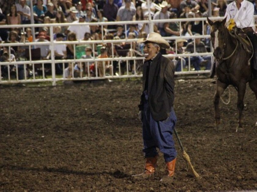 """A clown wears a Barack Obama mask at the Missouri State Fair. The announcer asked the crowd whether anyone wanted to see """"Obama run down by a bull,"""" according to a spectator."""