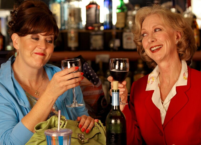"Melinda Gilb (left) and Ellen Crawford in San Diego's Rep's ""Walter Cronkite is Dead."""