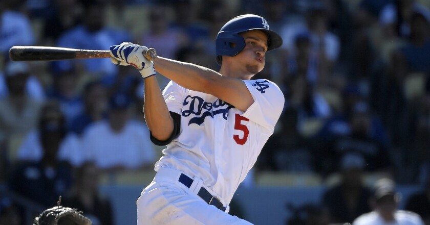 Dodgers shortstop Corey Seager swings at a pitch against the Cardinals.