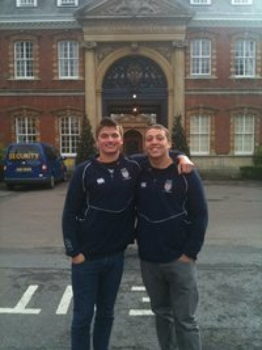 San Diego Mustangs Rugby teammates Billy Maggs (left) and Drew Gaffney stand on Easter Sunday in front of Wellington College, Berkshire, England. The two were selected to the USA Rugby High School All-American U17 team, and are participating in an international tournament near London from April 7 to April 13. Photo: Dave Maggs.