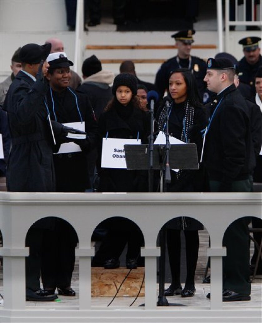 Military personnel act as stand-ins for President-elect Barack Obama and family on the West Front of the Capitol during a rehearsal for the Inauguration Ceremony in Washington, Sunday, Jan. 11, 2009. Stand-ins left to right are President-elect: Army Sgt. Derrick Brooks, Michelle Obama: Navy Yeoman