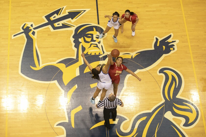 Cathedral Catholic's Ice Brady (right) and LJCD's Breya Cunningham go up for the tip to start Saturday's Open Division final at UC San Diego, won by the Torreys 54-37. Both teams advance to this week's regionals.
