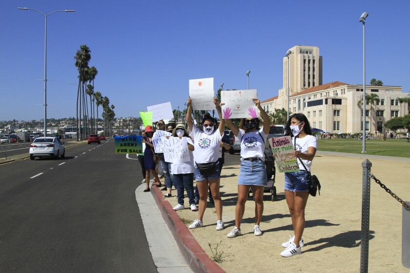 About 60 protesters gathered along Harbor Drive on Aug. 29 for the Where's Our Children rally