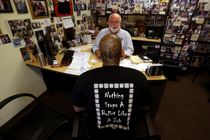 Father Gregory Boyle, founder and director of Homeboy Industries, in his office.