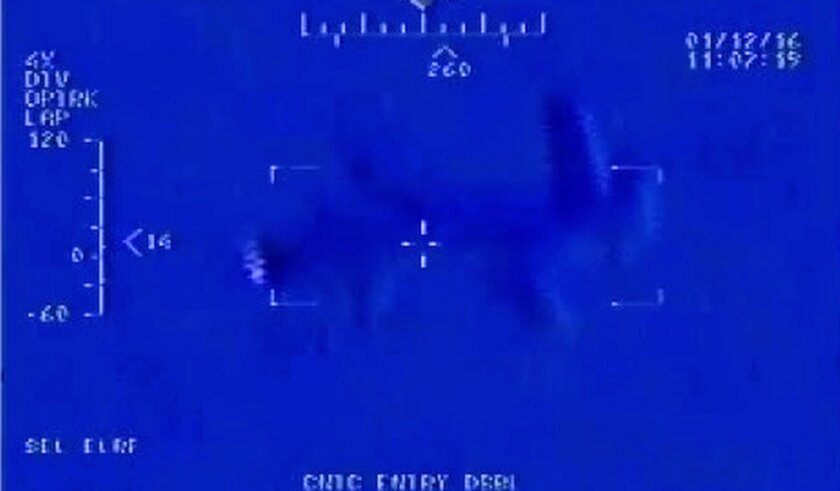 "This Jan. 12, 2016, still image taken from video made available by the U.S. Navy shows Iranian drone"" Shaheed "" as it flies over the USS Harry S. Truman. That's according to an internal U.S. Navy report on the Jan. 12 incident obtained Wednesday by The Associated Press through a Freedom of Informat"