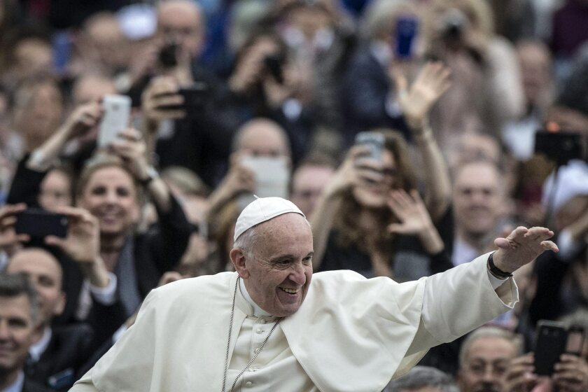 Pope Francis greets the faithful arriving in St. Peter's Square on Wednesday in Vatican City.