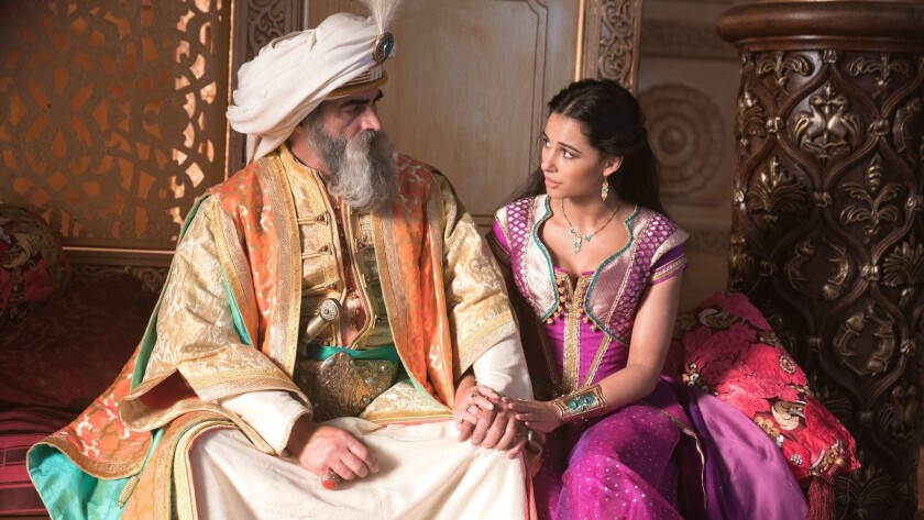 (L-R)- Navid Negahban is the Sultan and Naomi Scott is Jasmine in Disney?s live-action ALADDIN, dire