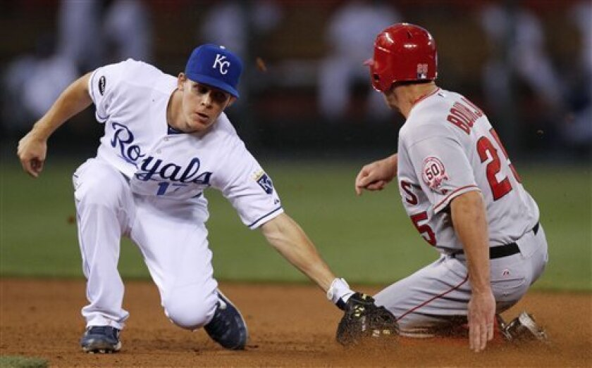 Los Angeles Angels' Peter Bourjos (25) slides safely into second past the tag of Kansas City Royals second baseman Chris Getz for a steal in the sixth inning during a baseball game Tuesday, May 31, 2011, in Kansas City, Mo. (AP Photo/Ed Zurga)