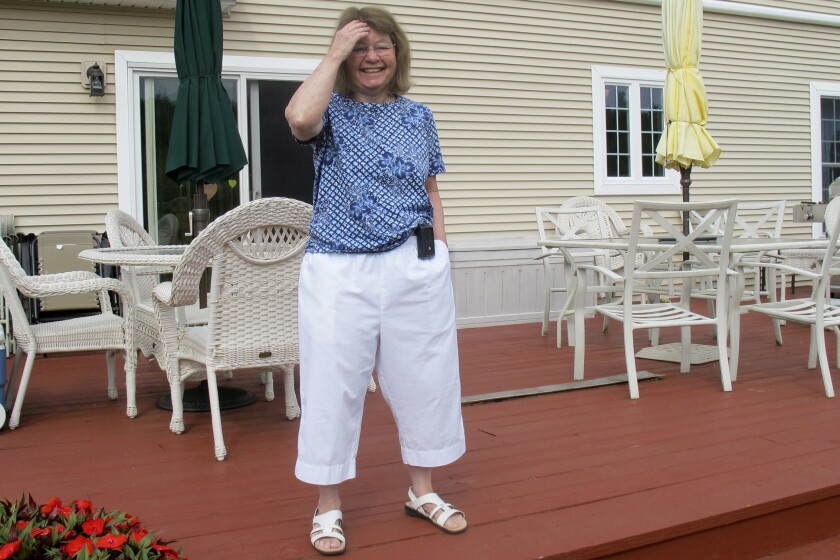 Jean Grady smiles at her home in Westford, Vt. Grady wears an insulin pump to help manage her diabetes.