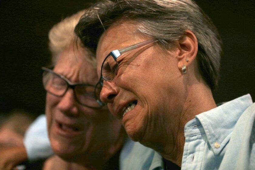 Judy Rettig, right, and Karen Castelloes cry during a prayer vigil Joy Metropolitan Community Church after a fatal shooting at the Pulse Orlando nightclub Sunday, June 12, 2016, in Orlando, Fla. (AP Photo/Chris O'Meara)