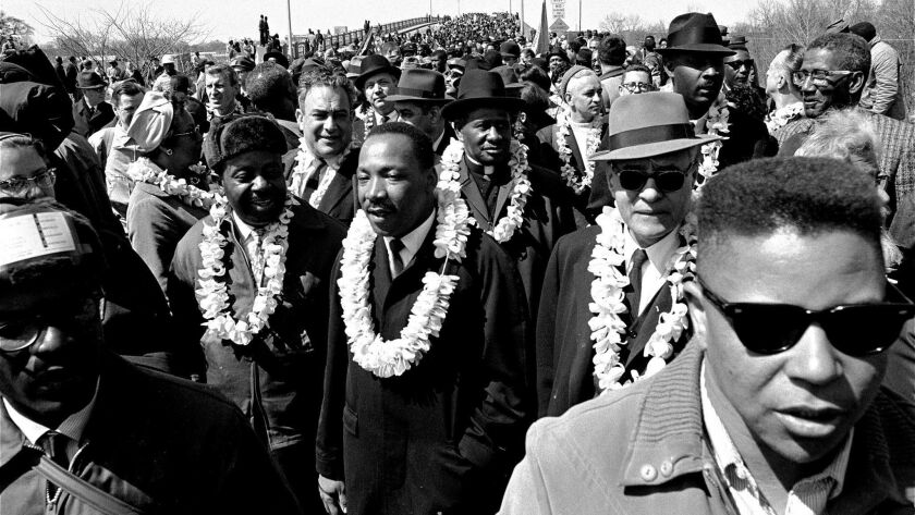 ** FILE ** Martin Luther King, Jr. and his civil rights marchers head for Montgomery, the state's ca